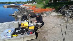 sampling nearshore water near Keewatin